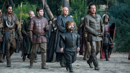 Podrick, Tyrion, and Bronn approach the Dragon Pit escorted by Lannister soldiers
