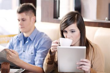 Woman reading tablet in a coffee shop
