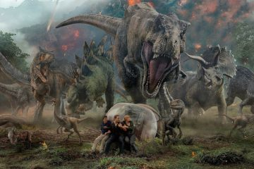 Franklin, Owen, and Claire are trapped in a dinosaur stampede in the poster for Jurassic World: Fallen Kingdom