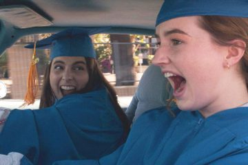 Molly (Beanie Feldstein) and Amy (Kaitlyn Dever) drive to graduation in Booksmart